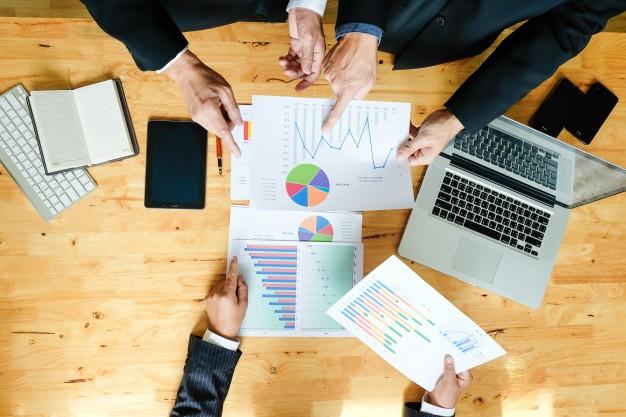 A sales team going through analytics